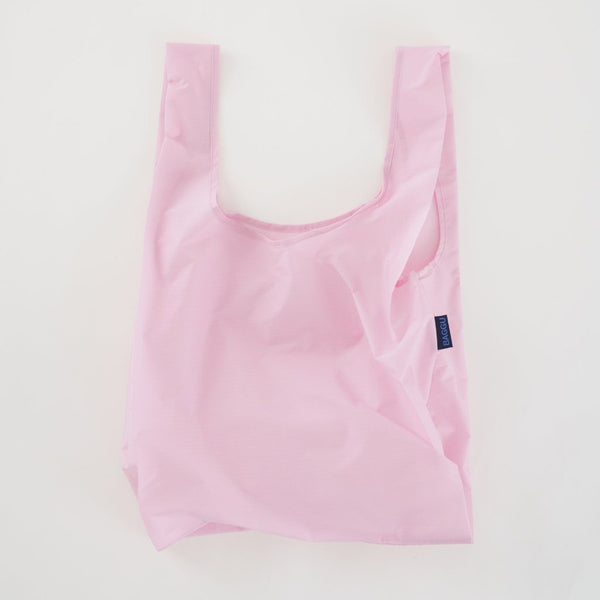 Minimalist reusable ripstop nylon bag by Baggu. Perfect for packing your day's groceries, lunch, or any everyday essentials. Now in Cotton Candy Pink at Port of Raleigh
