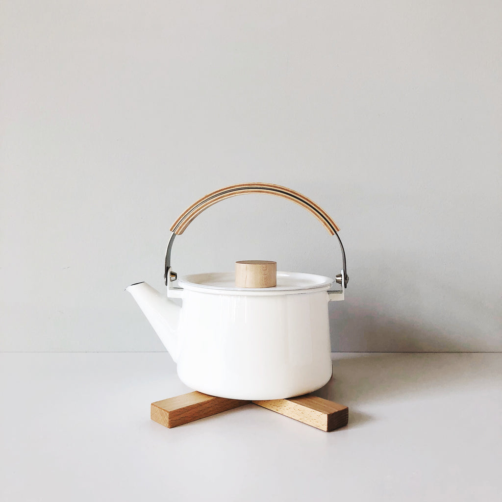 A tea kettle with high end details. Made in enamel-coated steel with a wood handle, the design can adapt and enhance any homeowner's style. Made in Japan by Makoto Koizumi, the Kaico kettle is sure to make your daily tea time even more enjoyable. at Port of Raleigh