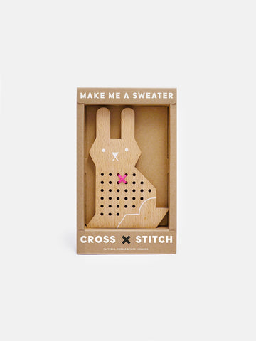 A simple and timeless cross-stitching craft kit with a modern appeal. Natural wood and wool for cross stitch activity time for kids by Moon Picnic