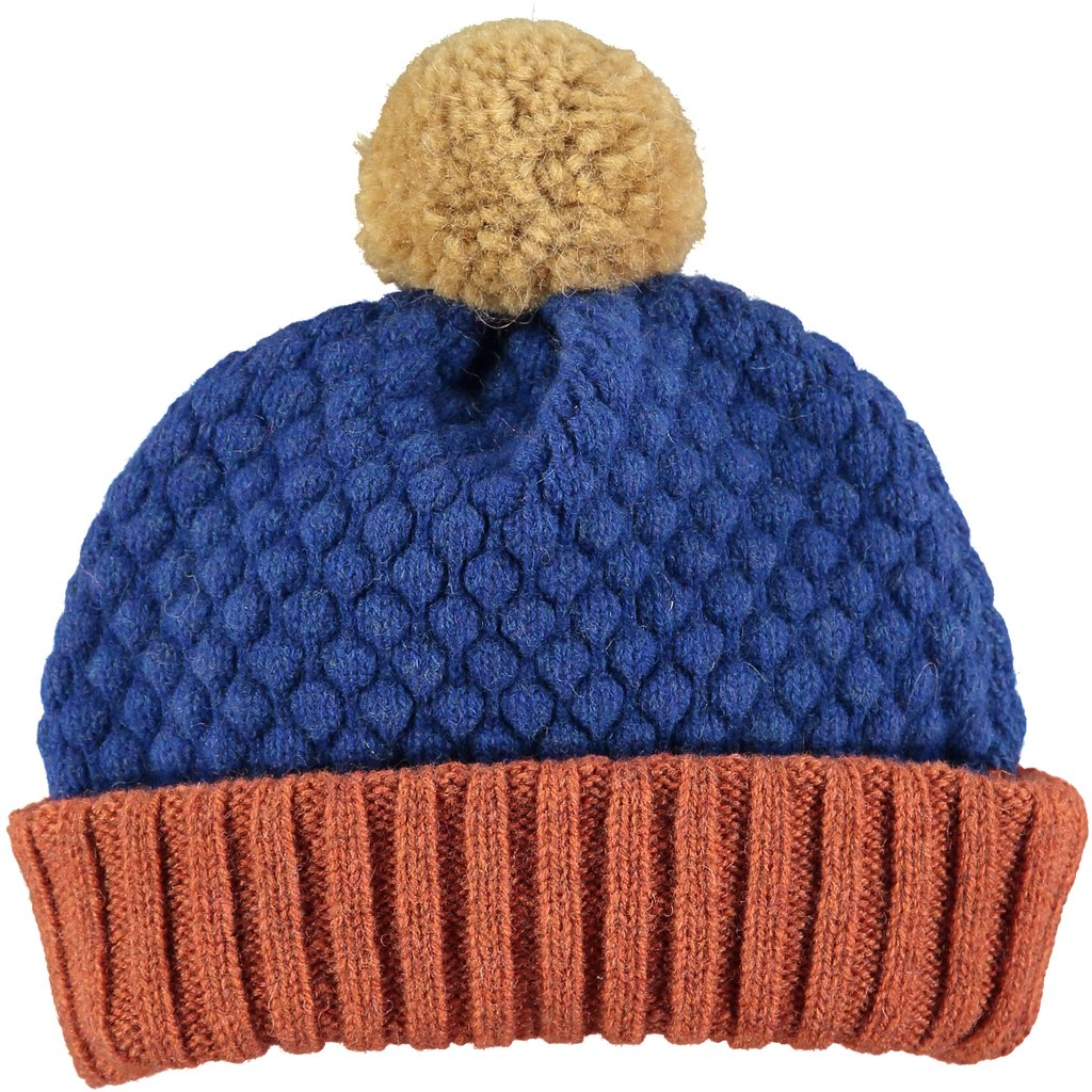 Playfully textured and color blocked kids' bobble hats made in London of 100% lambswool by Catherine Tough at Port of Raleigh