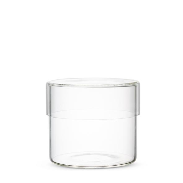 Simple glass canisters with lid for minimalist storage in the bathroom, office, vanity, and kitchen. Heat resistant glass designed by Kinto Japan