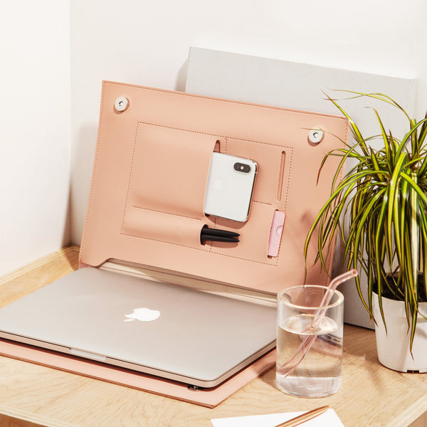 "A vegan leather folio to organize everything you need for work. Sized to hold a 13"" laptop or notebook, this folio will keep your device secure, and has extra pockets for a cell phone, notes, receipts, and pens. Designed by Poketo, this simple and clean folio will be there for every project, every day."