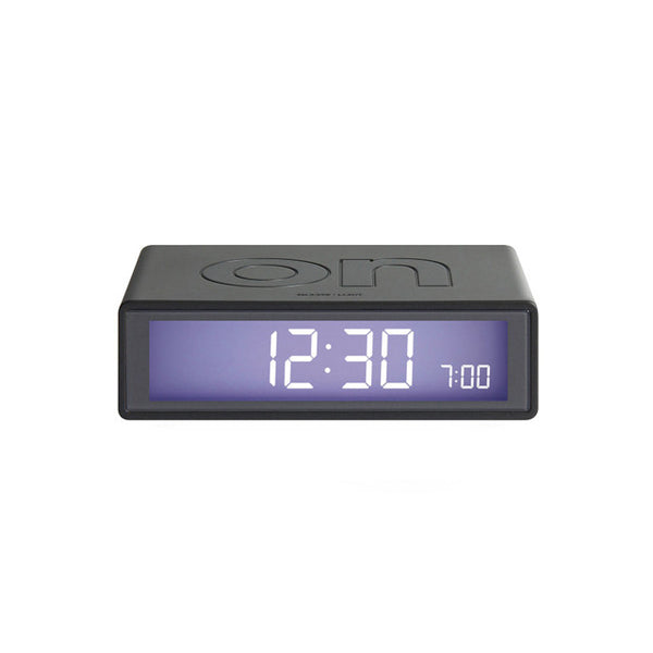 Modern, minimal, and simple, award-winning alarm clock that turns on and off with just a flip. Lightweight and wrapped in silicone, it is perfectly compact to dress your nightstand or pack away for travel. Has a touch sensor snooze and light activation, made by Lexon.