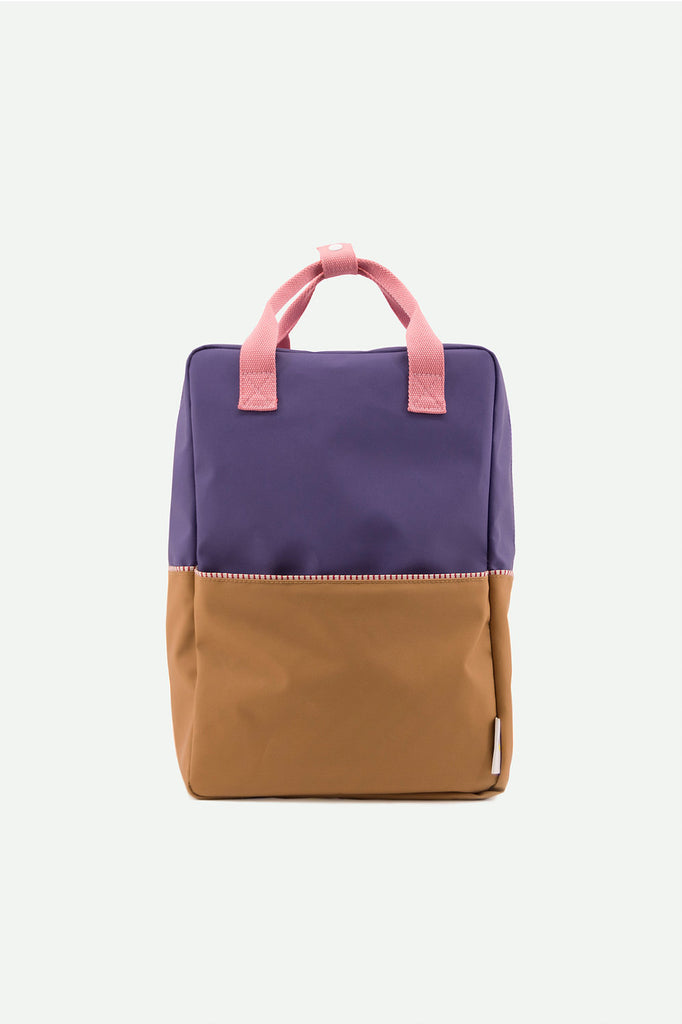 Modern backpack for little and big kids alike in modern color combination by Sticky Lemon. Made of recycled PET water bottles, this durable and water proof Nylon canvas is perfect for school, work, and urban adventures. at Port of Raleigh