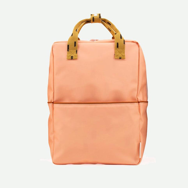 Modern backpack for little and big kids alike in modern color combination by Sticky Lemon. Made of recycled PET water bottles, this durable and water proof Nylon canvas is perfect for school, work, and urban adventures.