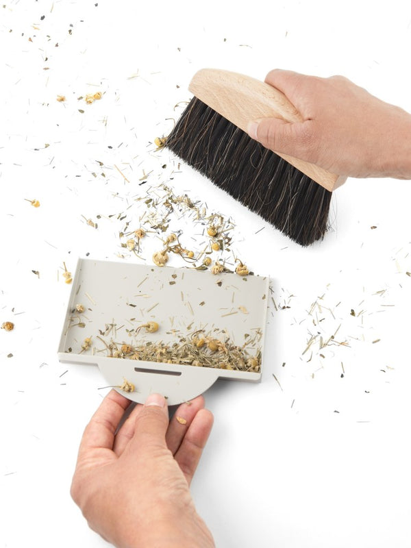 A handheld brush and dustpan set, perfect for cleaning up even the smallest of messes with precision. Made in France, of beech wood, horsehair and synthetic bristles and steel dustpan.