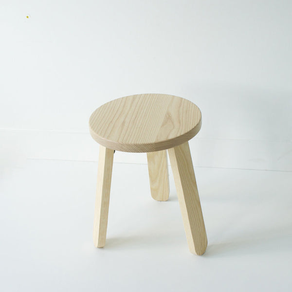 Modern and minimalist simple wood chair in solid Ash wood by Canadian design studio KROFT. Friendly silhouette and solid construction make this stool perfect as a side table, night stand, and well, a sitting stool. Made in Canada. at Port of Raleigh