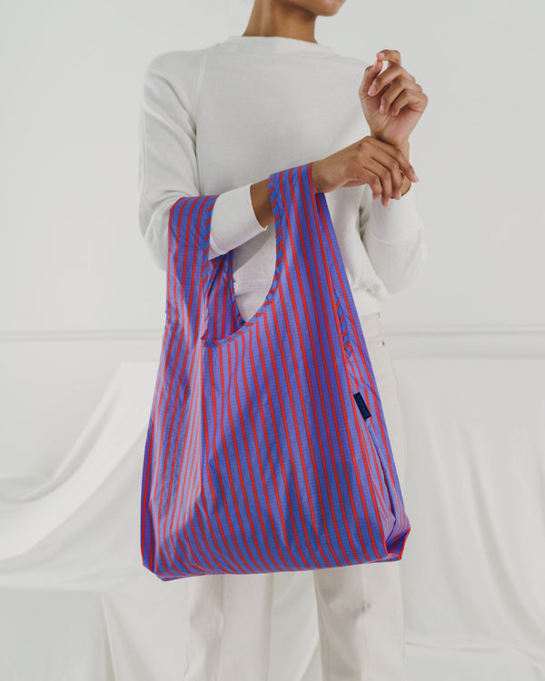Minimalist reusable ripstop nylon bag by Baggu. Perfect for packing your day's groceries, lunch, or any everyday essentials. Now in bright Optic Stripe.