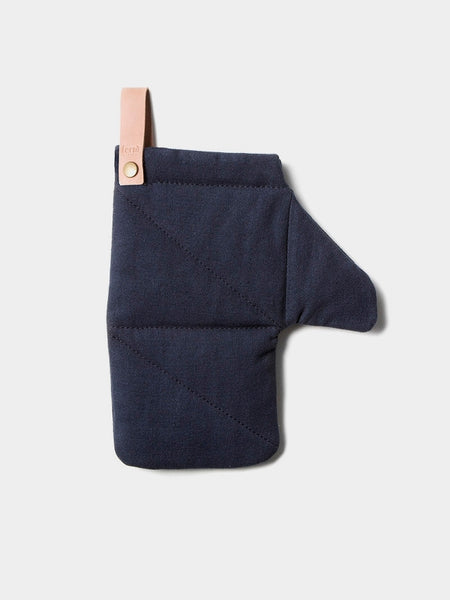 Simple and modern quilted oven mitt in cotton with removable leather detail at Port of Raleigh