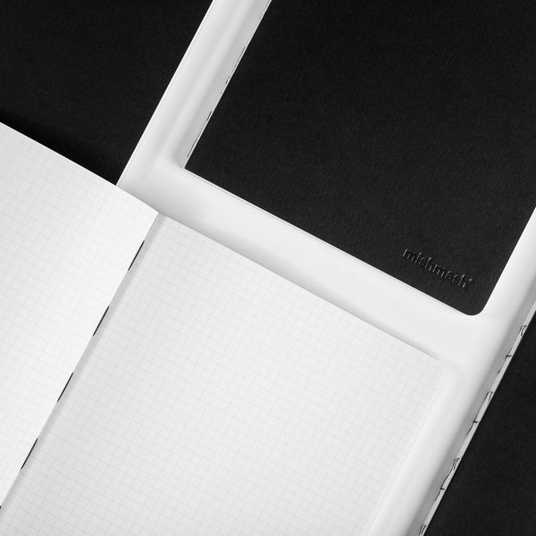 Minimalist grid paper notebook by Mishmash