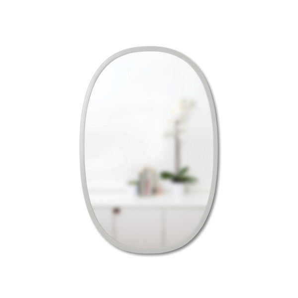 Simple oval wall mirror with thin rubber trim for entryway, living space, or bathroom. Hangs vertically or horizontally. By Umbra