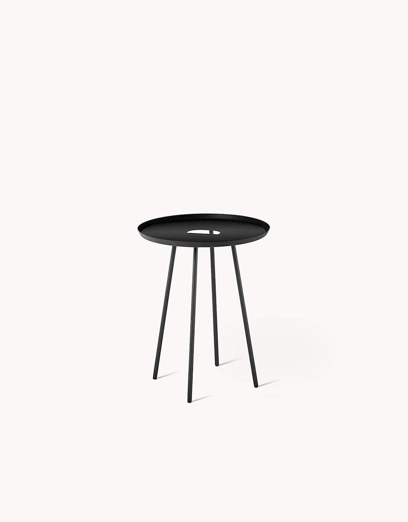 A simple and minimal side table with clever details. Made of fine sand coated steel, it has a hole in the middle to function as a handle for easy transporting, and for organizing cords. Designed by Dims. at Port of Raleigh