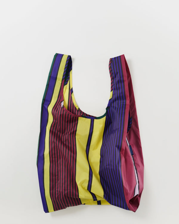 Minimalist reusable ripstop nylon bag by Baggu. Perfect for packing your day's groceries, lunch, or any everyday essentials. Now in a colorful scarf-inspired stripe.