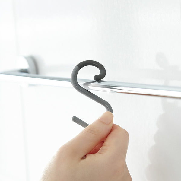 For easy and modern bathroom organization, the S Hook is the solution. Soft, subtle, and with an ingenious flexible head, it can attach to any rod so you can hang and rehang with ease.