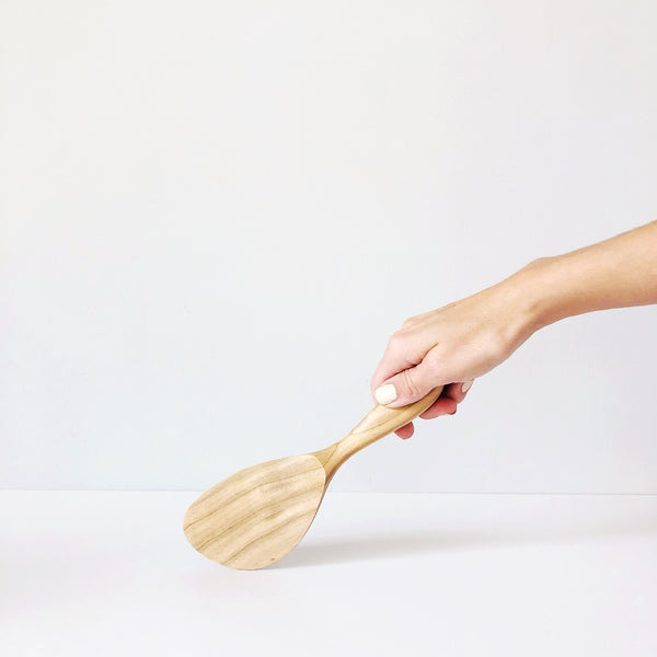 A small wooden spatula, based on the timeless rice scoops in Japan. Sculpted in Cherry Wood on the island of Miyajima, with the lovely grain coming through, this simple but gorgeous tool will aid all of your cooking adventures.