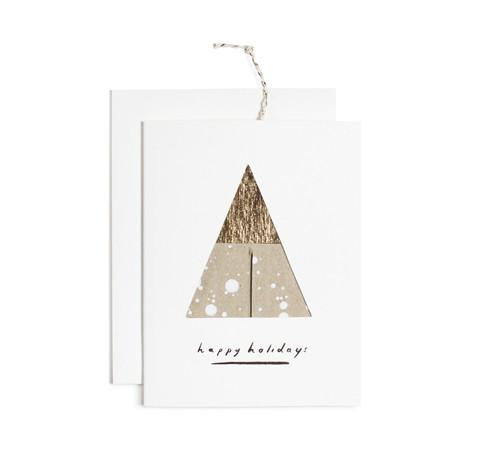 Wish a Merry Christmas with this modern, hand painted card with 2 flat circles inside that assemble into an ornament. Each card is gold foil stamped, and comes with a solid white envelope and gold string for hanging. Painted in Iowa by Moglea.