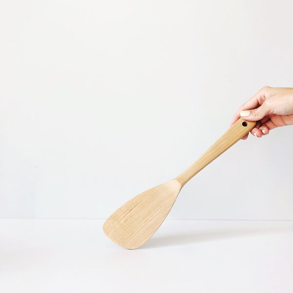 "A 12"" wooden spatula, based on the timeless rice scoops in Japan. Sculpted in Cherry Wood on the island of Miyajima, with the lovely grain coming through, this simple but gorgeous tool will aid all of your cooking adventures."