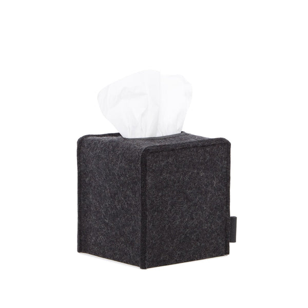 A soft and simple tissue box cover for the sometimes unsightly store-bought boxes. Made of merino wool felt with leather stitched reinforcement, just slip the cover over any tissue box to help your tissues add to your aesthetic. Made in USA by Graf Lantz.