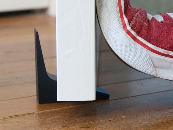 A door stopper that actually works. Made of Silicone and a unique two-edge design, this modern and minimalist door stop comes in a set of two