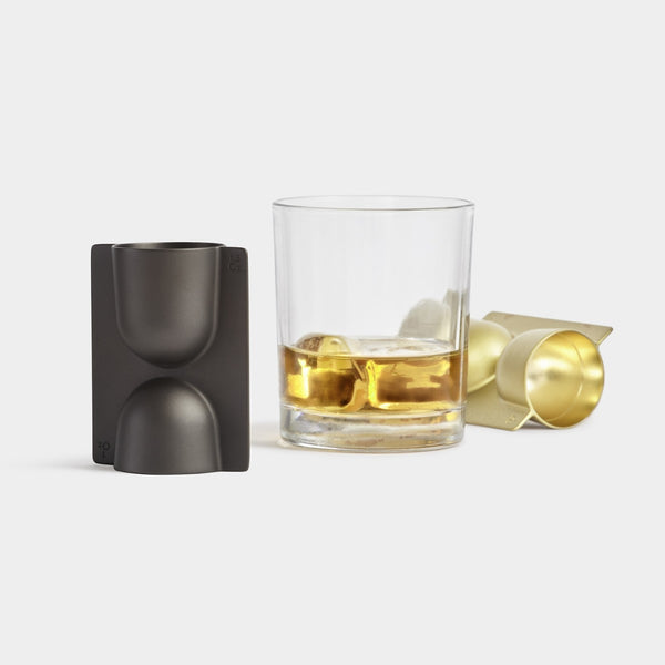Trophy bar jigger in plated brass and gun metal. Modern barware accessories by Umbra Shift