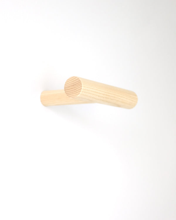 Modern and minimal large wood wall hook with three areas for hanging. Designed by Kroft Studio