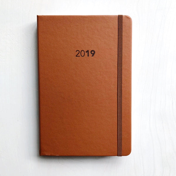 This simple, but detailed and thoughtfully-designed weekly planner makes staying organized easier and sleek-looking. Created by UPStudio in Raleigh, NC, every page and every feature was carefully considered. Is has a black leather cover, elastic closure, and lots of graph paper in the back for notes overtime. This 2019 weekly planner gives each user the ability to both plan well and stay flexible. at Port of Raleigh
