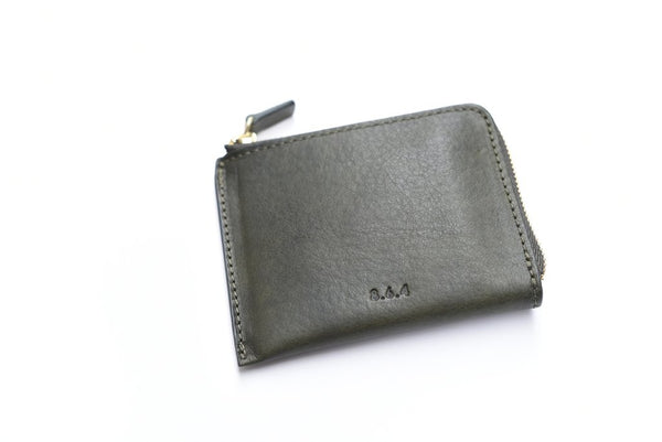 A wallet for light days, travelling, and the staunch minimalist. Made in NYC with vegetable tanned leather, this simple but lovely textured zip wallet can still fit more than its fair share of cash, cards, and even coins.