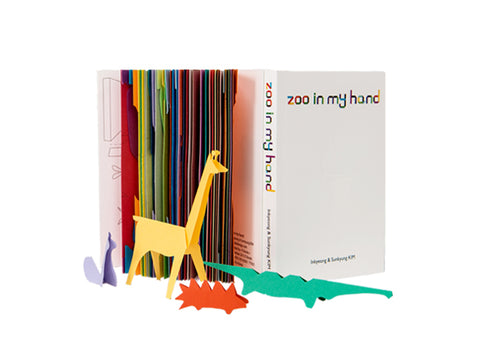 Colorful animal cut out and pop up book that turns craft time into playtime; also a great introduction to origami. Designed by IK & SK