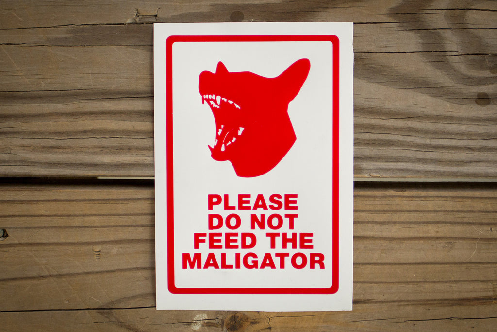 """Please Do Not Feed The Maligator"" Sticker"