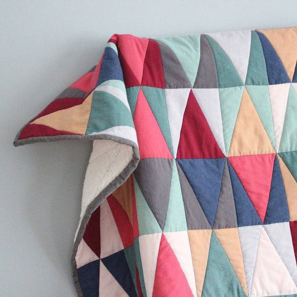 Baby Quilt made from Organic Cotton - Mirroring Triangles in Pink, Red, Blue, and Gray - Upper Earth