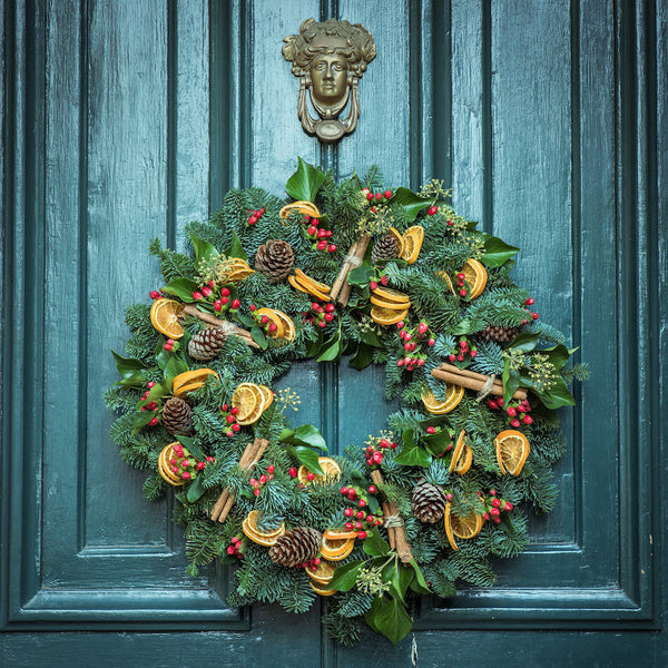 Christmas wreath hanging on a door.