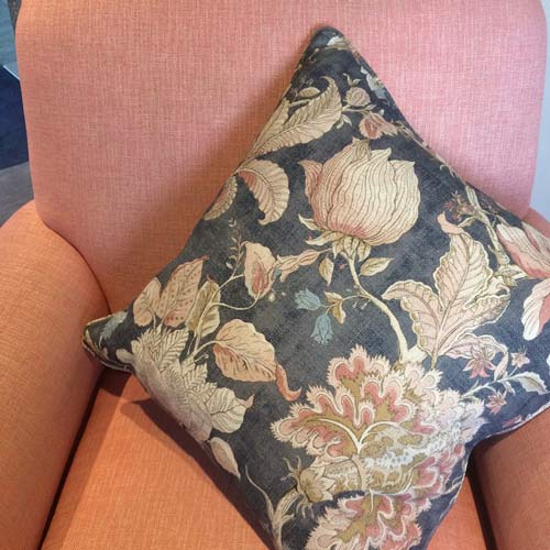 pink floral and denim blue cushion on pink chair