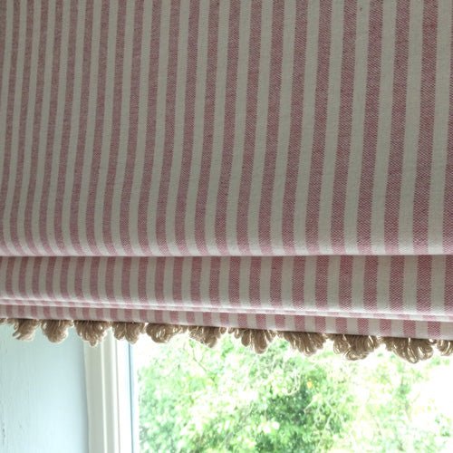 roman blind in pink and white stripe with pretty trim