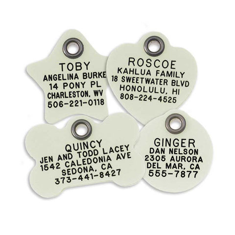 4 glow-in-the-dark plastic tags: star shape, heart shape, bone shape, and round