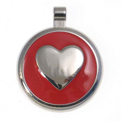Round metal tag with red enamel on the front surrounding a metal heart design