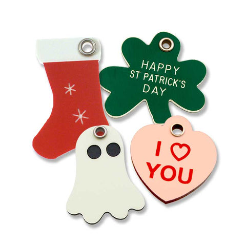 "Red holiday stocking tag, green shamrock tag, glowing ghost tag, and pink ""I Heart You"" heart shaped tag"