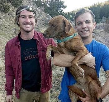 Two people and a rescued dog.