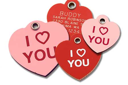 Red and pink heart shaped pet tags with I Heart You stamped on the front and engraving on the back