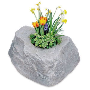 Planter Faux Rock 132 in Fieldstone with flowers planted