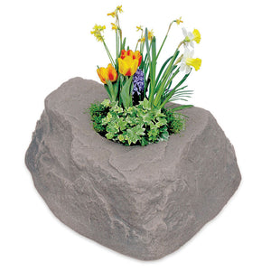 Planter Faux Rock 132 with flowers planted