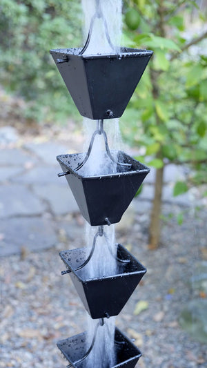 Medium Square Cups Black Rain Chain with water flowing through multiple cups