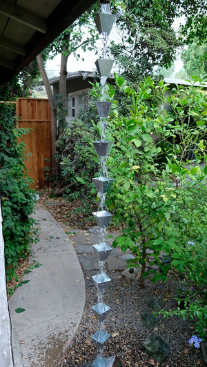 Full length image of Medium Galvanized Square Cups Rain Chain on home with water running through cups
