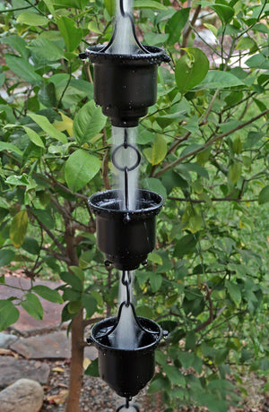 Black Naoki Cups Rain Chain with water flowing through multiple cups