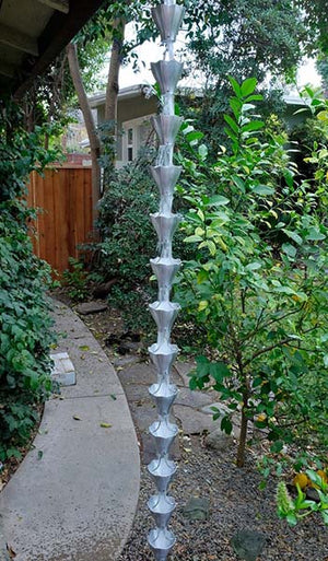 Star Flower Cups Rain Chain in aluminum on house with water flowing through multiple cups