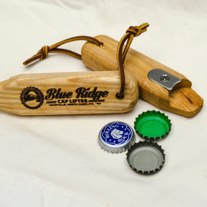 The Blue Ridge Cap Lifter next to bottle caps it removed with no damage