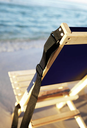 The Blue Ridge foldable Chair with strap in navy blue at beach
