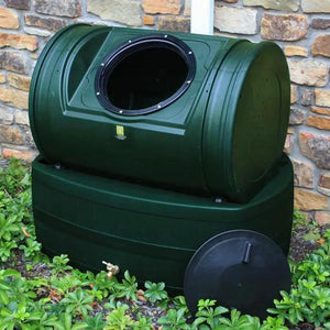 Compost Wizard Hybrid in green color being used in yard