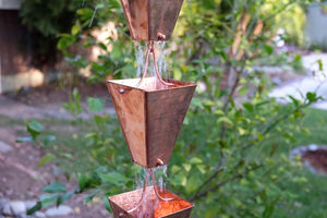 Large Tapered Cup style rain chain in Copper with water running through cups