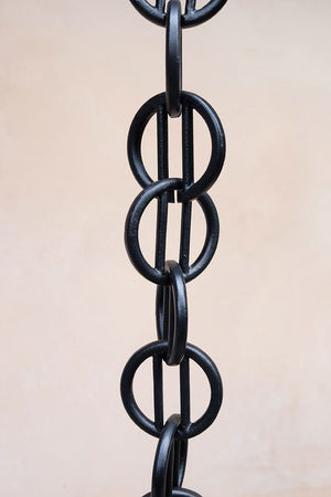 Close up of multiple black Cast Zen Loops Rain Chain links