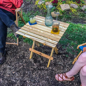 The Blue Ridge Folding portable Side Table in the backyard to hold drinks